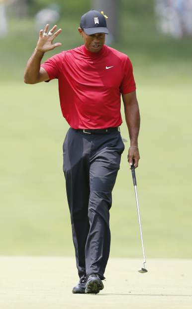 Tiger Woods reacts to making a putt on the second hole during the final round of the Memorial golf tournament Sunday, June 2, 2019, in Dublin, Ohio. (AP Photo/Jay LaPrete)