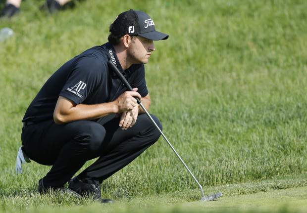 Patrick Cantlay lines up his putt on the 17th hole during the final round of the Memorial golf tournament Sunday, June 2, 2019, in Dublin, Ohio. (AP Photo/Jay LaPrete)