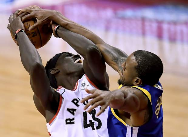 Golden State Warriors forward Andre Iguodala (9) blocks Toronto Raptors forward Pascal Siakam (43) as he drives to the net during the second half of Game 2 of basketball's NBA Finals, Sunday, June 2, 2019, in Toronto. (Frank Gunn/The Canadian Press via AP)