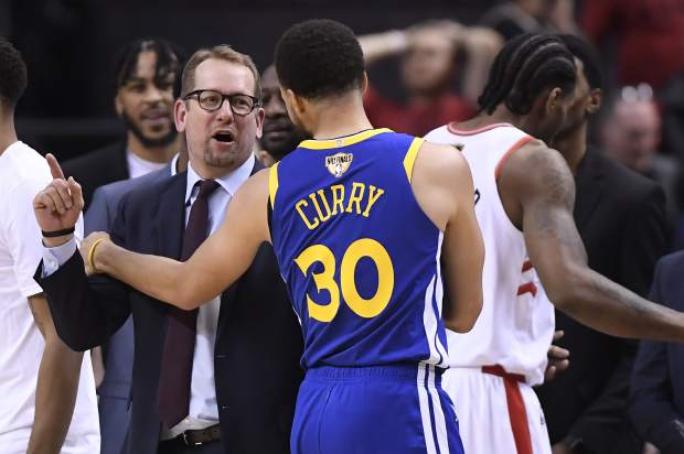 Toronto Raptors head coach Nick Nurse and Golden State Warriors guard Stephen Curry (30) exchange words on the court during second half of Game 2 of basketball's NBA Finals, Sunday, June 2, 2019, in Toronto. (Frank Gunn/The Canadian Press via AP)