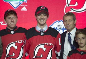 Devils select US center Hughes with 1st pick in NHL draft