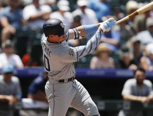 San Diego Padres' Hunter Renfroe connects for a two-run home run off Colorado Rockies starting pitcher Peter Lambert in the first inning of a baseball game Sunday, June 16, 2019, in Denver. (AP Photo/David Zalubowski)