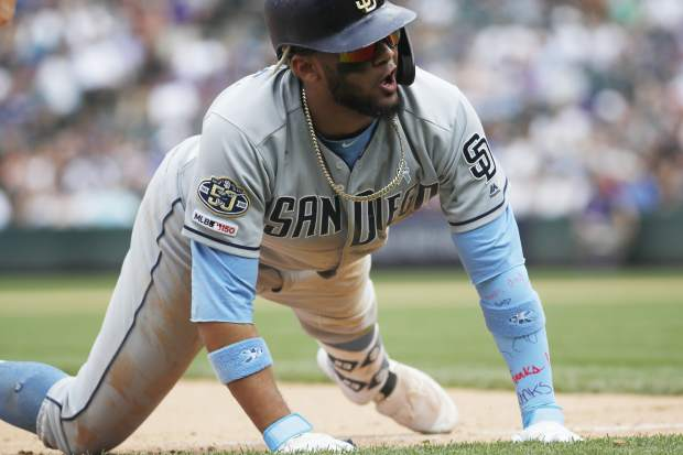 San Diego Padres' Fernando Tatis Jr. reacts after tripling off Colorado Rockies relief pitcher Bryan Shaw in the seventh inning of a baseball game Sunday, June 16, 2019, in Denver. (AP Photo/David Zalubowski)