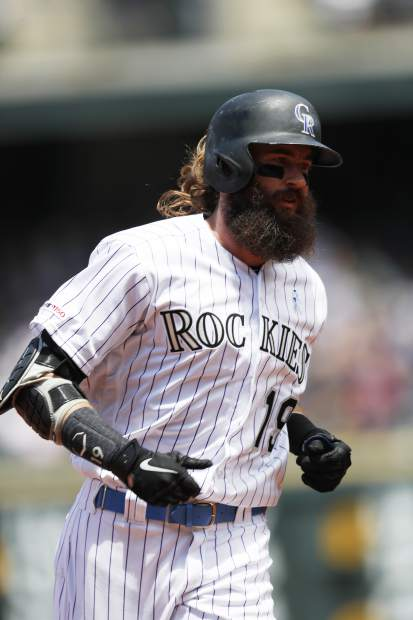 Colorado Rockies' Charlie Blackmon circles the bases after hitting a solo home run off San Diego Padres starting pitcher Nick Margevicius to lead off the bottom of the first inning of a baseball game Sunday, June 16, 2019, in Denver. (AP Photo/David Zalubowski)