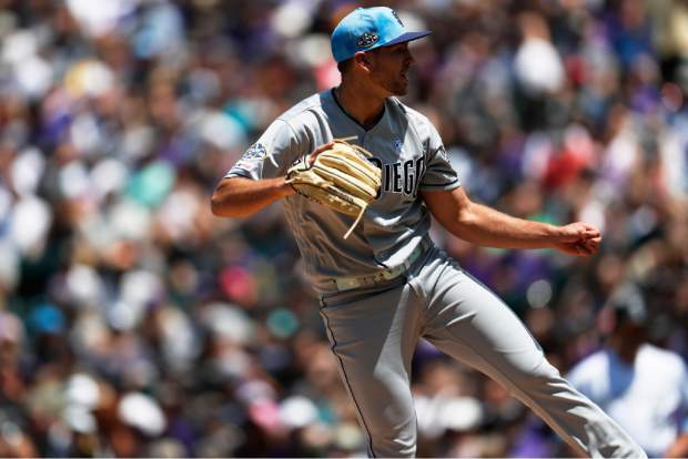 San Diego Padres starting pitcher Nick Margevicius works against the Colorado Rockies in the first inning of a baseball game Sunday, June 16, 2019, in Denver. (AP Photo/David Zalubowski)