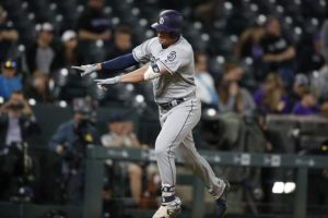 Renfroe hits 3 homers, Padres rally to stun Rox 16-12 in 12