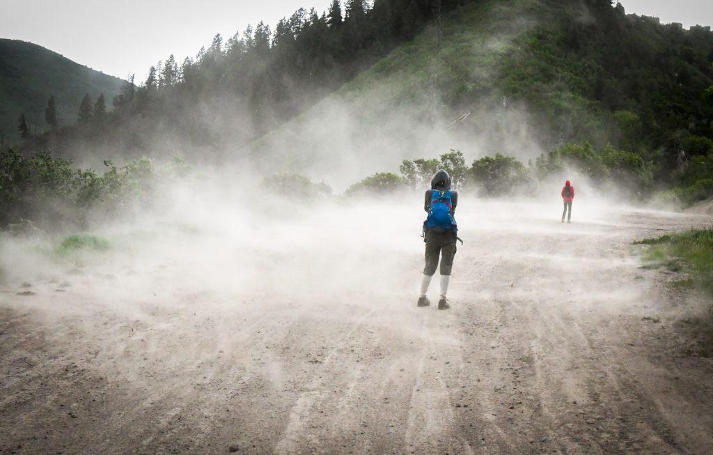 Hikers are caught in a wind storm above the RMR Quarry on Thursday evening during a hike around the quarry with Wilderness Workshop.