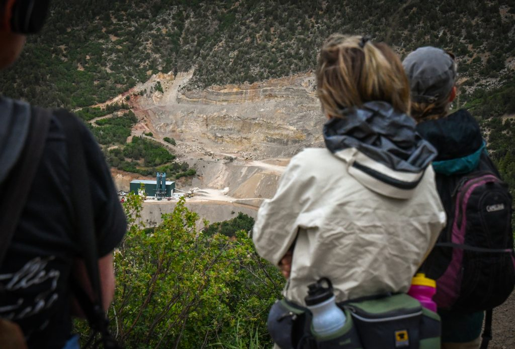 Hikers stop to look at the RMR Quarry near the Glenwood Caverns Adventure Park on Thursday evening during a hike around the quarry with Wilderness Workshop.