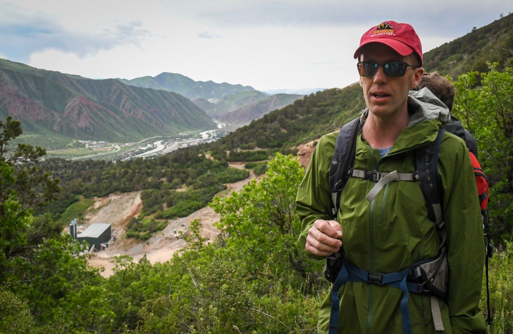 Jeff Peterson with the Glenwood Springs Citizens Alliance talks about the potentional impacts of the expansion of the RMR Quarry during a hike around the quarry with Wilderness Workshop on Thursday evening.
