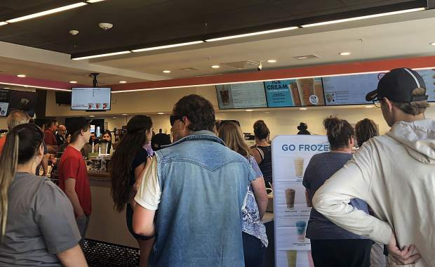 Customers wait in line at Dunkin Donuts last Friday on opening day of the Rifle location.