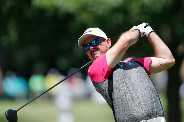 Rory Sabbatini drives on the second tee during the final round of the Rocket Mortgage Classic golf tournament, Sunday, June 30, 2019, in Detroit. (AP Photo/Carlos Osorio)