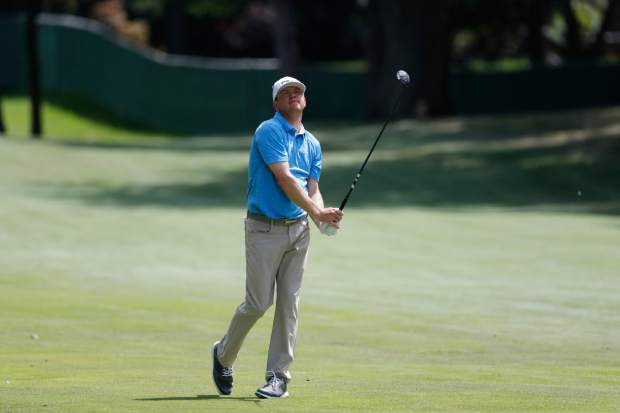 Nate Lashley watches his approach shot onto the seventh green during the final round of the Rocket Mortgage Classic golf tournament, Sunday, June 30, 2019, in Detroit. (AP Photo/Carlos Osorio)