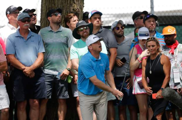 Nate Lashley watches his hit from the gallery onto the second green during the final round of the Rocket Mortgage Classic golf tournament, Sunday, June 30, 2019, in Detroit. (AP Photo/Carlos Osorio)