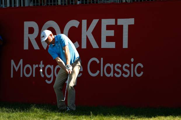 Nate Lashley hits onto the 17th green during the final round of the Rocket Mortgage Classic golf tournament, Sunday, June 30, 2019, in Detroit. (AP Photo/Carlos Osorio)