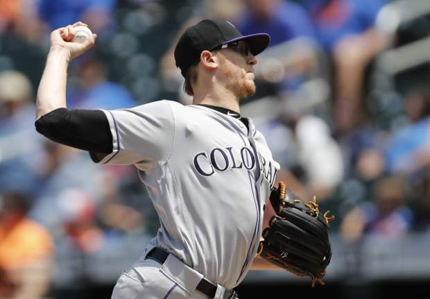 Colorado Rockies starting pitcher Jeff Hoffman throws during the first inning of a baseball game against the New York Mets, Sunday, June 9, 2019, in New York. (AP Photo/Kathy Willens)