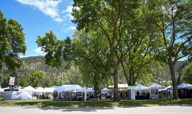 With a break in the weather visitors to the 122nd annual Strawberry Days Festival fill Sayre Park Sunday in Glenwood Springs. Mother Nature delt a few blows to thsi years festivals with on and off thursderstorms the first two days of the event.