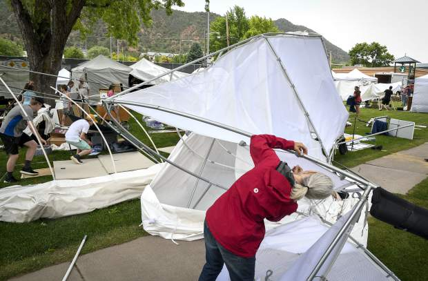 A microburst blew through Sayre Park causing significant damges to the vendors booths Thursday on the eve of the 122nd Strawberry Days Festival in Glenwood Springs.