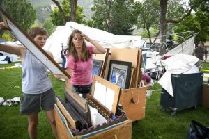 Afternoon storm damages art booths during Strawberry Days setup