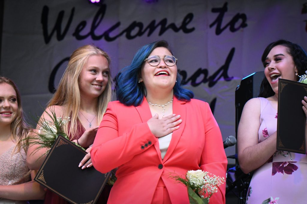 Miss Strawberry Days contestant Danny Starbuck reacts to winning the MIss Congeniality award at the 2019 crowning ceremony on Friday evening.