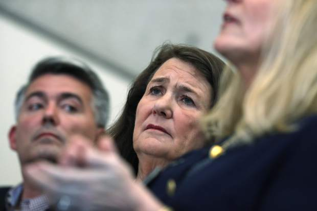 U.S. Rep. Diana DeGette, D-Colo., center, joins U.S. Sen. Cory Gardner, R-Colo., back, in listening as Nancy Hogshead-Makar, an Olympian who won in 1984 and now resides in Jacksonville, Fla., speak during a news conference to announce a plan to introduce legislation aimed at reforming the U.S. Olympic Committee Monday, June 17, 2019, in Denver. Nearly a dozen Olympic athletes were on hand to lend their support to the measure, which DeGette plans to introduce this week. (AP Photo/David Zalubowski)