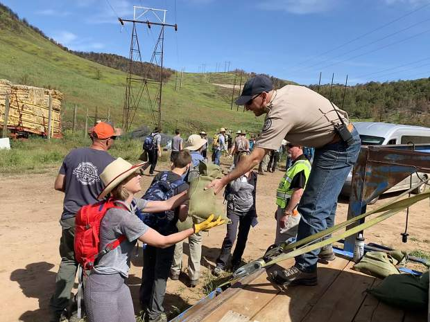 Nearly 300 volunteers came together Saturday, June 15, 2019, to help reseed part of the Colorado Parks and Wildlife land on Basalt Mountain that was destroyed by the Lake Christine Fire in 2018.