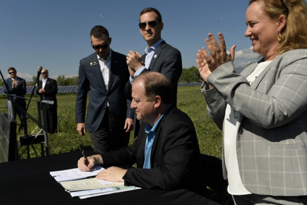 Jared Polis signs renewable energy bill in Colorado