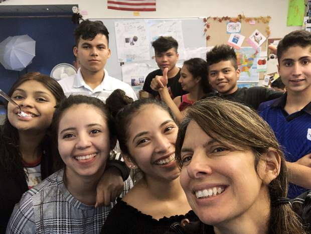 Basalt High School teacher Leticia Guzman Ingram is surrounded by students earlier this school year. Imgram is a Lindblad Expeditions and National Geographic Grosvenor Teacher Fellow for 2019.