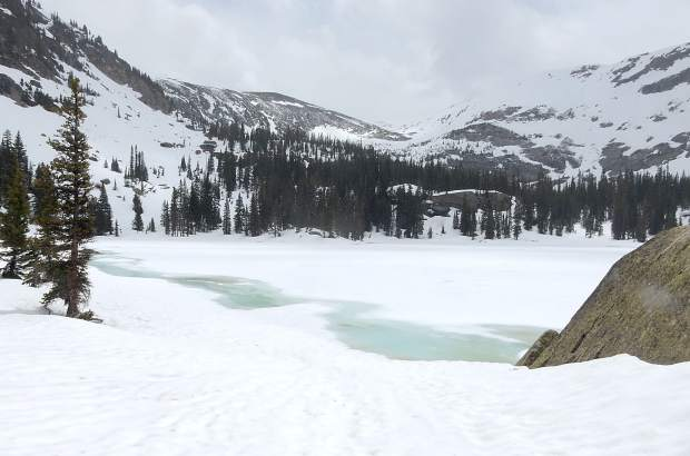 Lower Savage Lake in the Upper Fryingpan River basin remained covered with snow on Saturday. A significant amount of the snowpack in the basin hadn't melted yet.