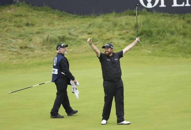 Ireland's Shane Lowry lifts his club to celebrate as he wins the British Open Golf Championships at Royal Portrush in Northern Ireland, Sunday, July 21, 2019.(AP Photo/Peter Morrison)