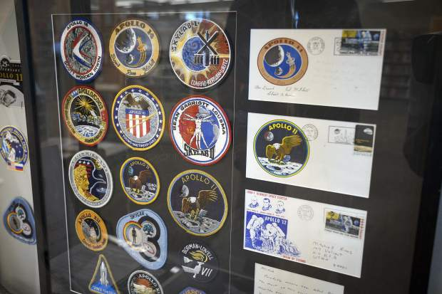 Tom Collins' display includes all his patches from the Apollo program. The display will be on exhibit for the next two months at the Rifle Library.
