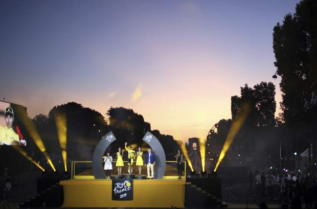 Tour de France winner Colombia's Egan Bernal wearing the overall leader's yellow jersey stands on the podium after the twenty-first stage of the Tour de France cycling race over 128 kilometers (79.53 miles) with start in Rambouillet and finish in Paris, France, Sunday, July 28, 2019. (AP Photo/Rafael Yaghobzadeh)