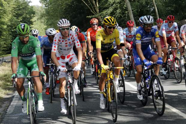 Colombia's Egan Bernal wearing the overall leader's yellow jersey, France's Romain Bardet wearing the best climber's dotted jersey, Slovakia's Peter Sagan wearing the best sprinter's green jersey and France's Julian Alaphilippe ride during the twenty-first stage of the Tour de France cycling race over 128 kilometers (79,53miles) with start in Rambouillet and finish in Paris, France, Sunday, July 28, 2019. (AP Photo/Thibault Camus)