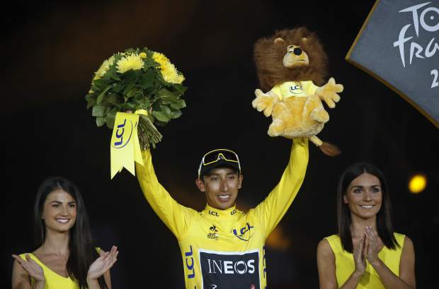 Colombia's Egan Bernal stands on the podium after winning the 2019 Tour de France cycling race in Paris, France, Sunday, July 28, 2019. (AP Photo/Michel Euler)