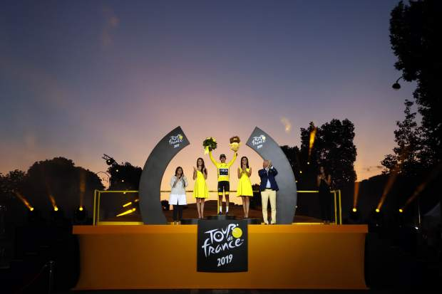 Tour de France winner Colombia's Egan Bernal celebrates on the podium after the twenty-first stage of the Tour de France cycling race over 128 kilometers (79.53 miles) with start in Rambouillet and finish in Paris, France, Sunday, July 28, 2019. (AP Photo/Christophe Ena)