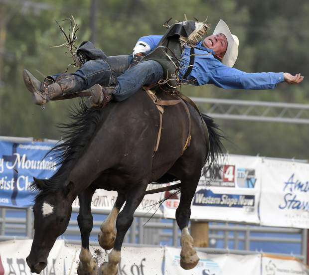 A bareback rider holds on for the eight-second whistle duirng last year's PRCA ProRodeo at Garfield County Fair in Rifle.
