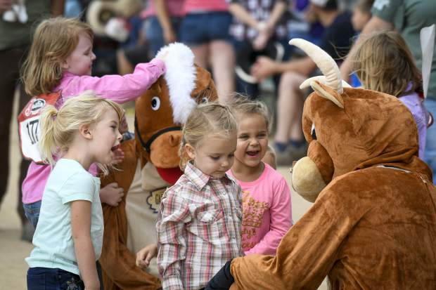 Contestants in the Lil Buckaroo and Princess Rodeo habe fun meeting the fair mascots before the start of the event Tuesday in Rifle.