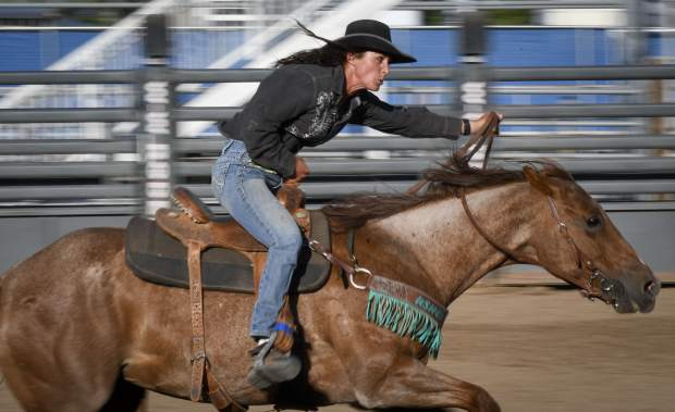 A contestant in the barrel racing event heads for home after rounding the last barrel during Monday's Family Rodeo.