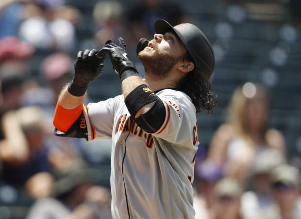 Brandon Crawford went 5 for 6 with two homers and tied a San Francisco Giants team record with eight RBIs in a win over the Colorado Rockies Monday in Denver.