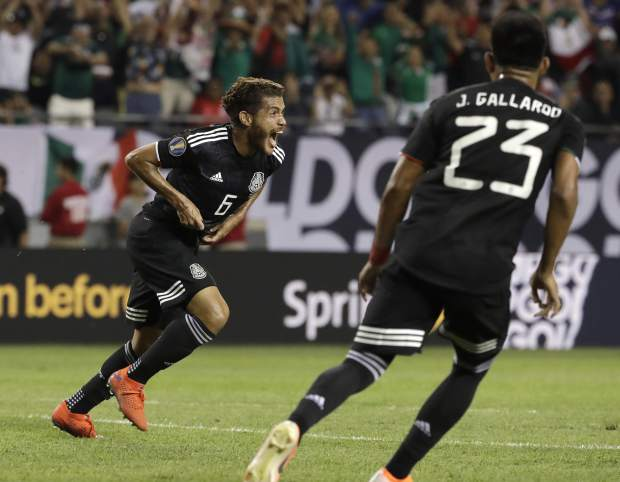 Mexico midfielder Jonathan Dos Santos (6) celebrates after scoring his first goal against United States during the second half of the CONCACAF Gold Cup final soccer match in Chicago, Sunday, July 7, 2019. (AP Photo/Nam Y. Huh)