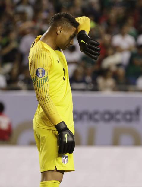 United States goalie Zack Steffen wipes his face during the second half of the CONCACAF Gold Cup final match against Mexico at Soldier Field in Chicago, Sunday, July 7, 2019. (AP Photo/Nam Y. Huh)