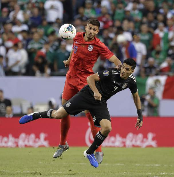 United States defender Matt Miazga, left, and Mexico defender Edson Alvarez battle for the ball during the first half of the CONCACAF Gold Cup final soccer match at Soldier Field in Chicago, Sunday, July 7, 2019. (AP Photo/Nam Y. Huh)