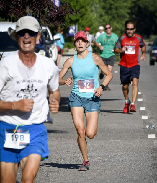 Runners make their way down Main Street in New Castle, the final stretch of the burst Hogback Hustle Saturday in New Castle. The 5k run and walk is the fifth of six races in the Colorado River Valley Charity Races Series.