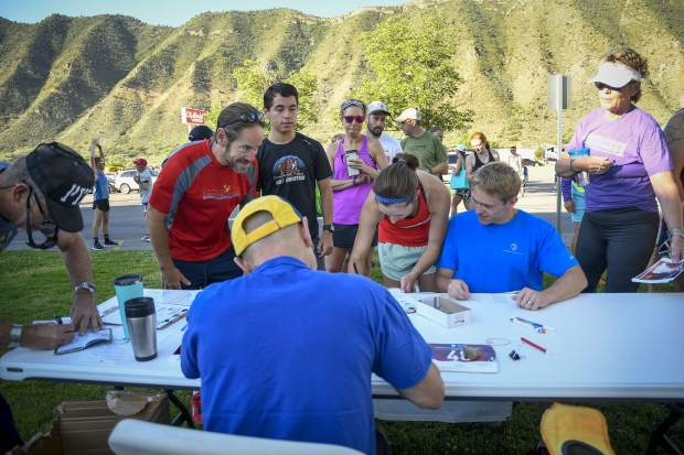 Participants in the 2019 Hogback Hustle register Saturday at City Market in New Castle. The 5k run and walk is the fifth of six races in the Colorado River Valley Charity Races Series.