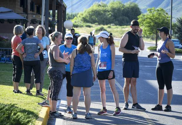 Participants in the 2019 Hogback Hustle wait near start line in front City Market in New Castle Saturday. The 5k run and walk is the fifth of six races in the Colorado River Valley Charity Races Series.