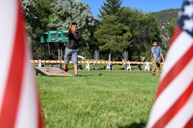 Seven-year-old Lionardo Lopez plays a game of cornhole with his family at the Glenwood Springs 4th of July Celebration at Two Rivers Park on Thursday afternoon.