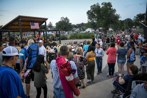 Crowds filter into Centennial Park for Rifle's annual Independence Day fireworks display Wednesday evening. Patrons to Rifle's annual Independence Day celeration were treated to the Symphony of the Valley performance and more.