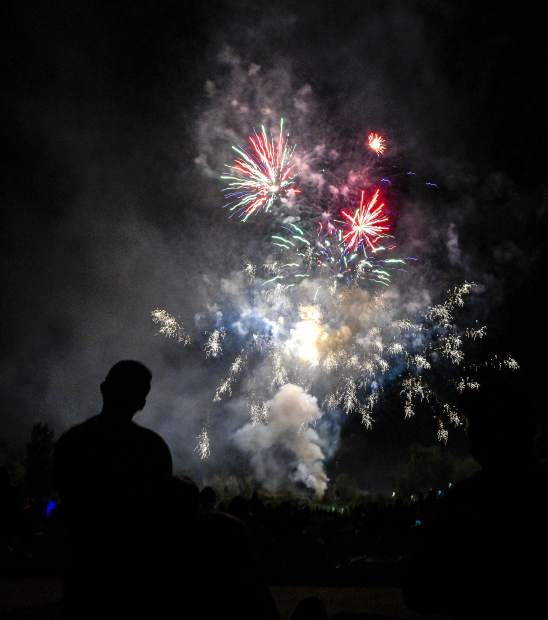 Fireworks light up the sky above Centennial Park Wednesday evening during Rifle's annual Independence Day celebration.