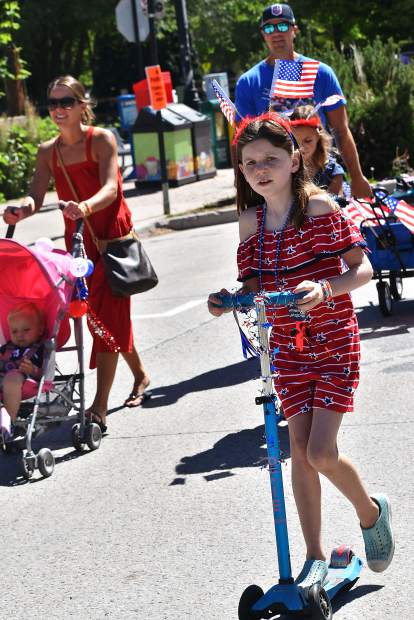 Ellie Hunter rides her scooter in the Carbondale 4th of July Kids Parade Thursday morning to celebrate Independence Day.