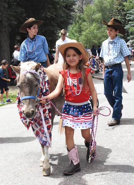 Emma Villareal, 6, of New Castle and her pony Padme walk Redstone Boulevard in the annual Redstone 4th of July Parade on Thursday.