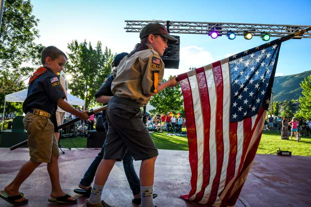 Local Cub Scout Troop 225 present the colors before the National Athem at the Glenwood Springs 4th of July Celebration at Two Rivers Park on Thursday afternoon.